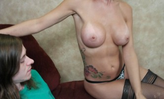 Sierra Luv rubs her hand up the thigh of a young man