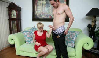 Alana Evans strokes the cock of a young man