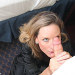 Mrs. West on her knees stroking her stepson's cock