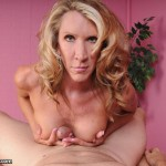 mature blonde masseuse giving a boobjob