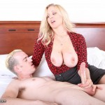busty clothed female jerking off a naked man