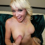 blonde milf rubs a cock on her tits