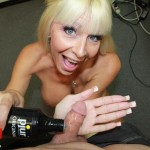 older blonde babe lubes up a prick