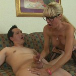 geeky older woman giving a handjob