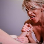 blonde milf giving a rough handjob