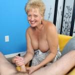 sexy milf giving a handjob