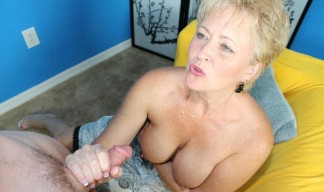 milf shows off her cum covered tits after giving a handjob