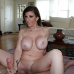 Sara Jay spreads her legs while giving a handjob
