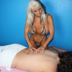 scantily-clad blonde milf massages a client