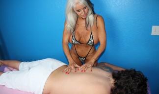 scantily-clad blonde milf massages a client