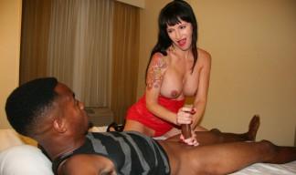 MILF with big tits jerks a big black cock