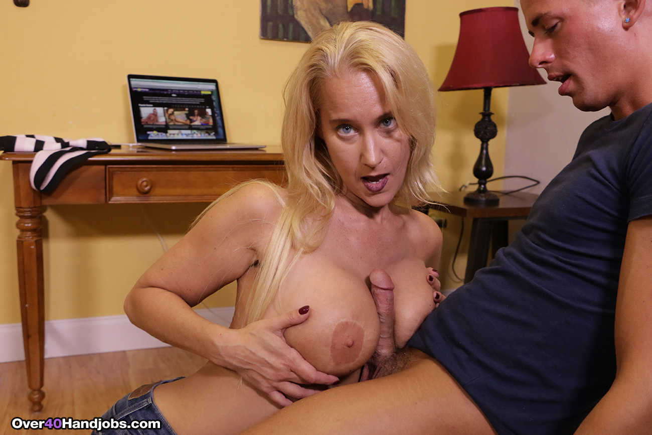 She strokes him until he cums on her tits 5
