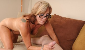 Felicity Rose is completely nude giving her stepson a good wank