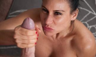 Shelia Marie wanks the paper boy's cock as hard as she can