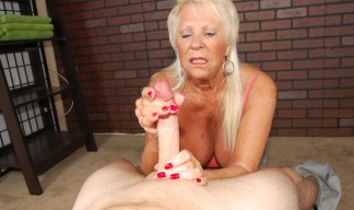 mature blonde jerking a cock