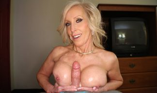 mature blonde giving a titjob