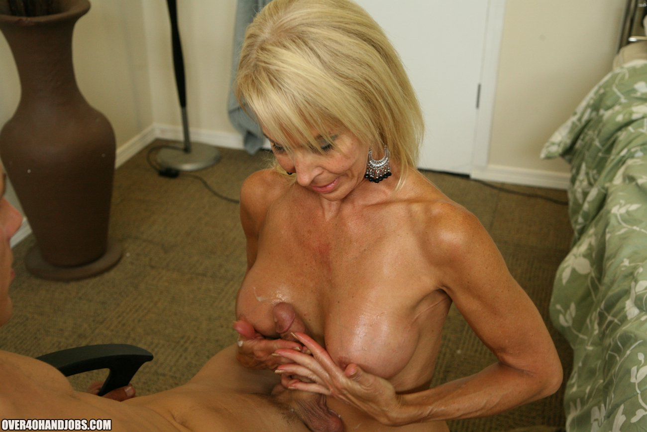 erica lauren blond milf jacking off a cock on