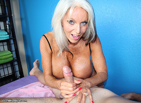 3 Handjob Movies - Busty milf massages huge cock of Russel